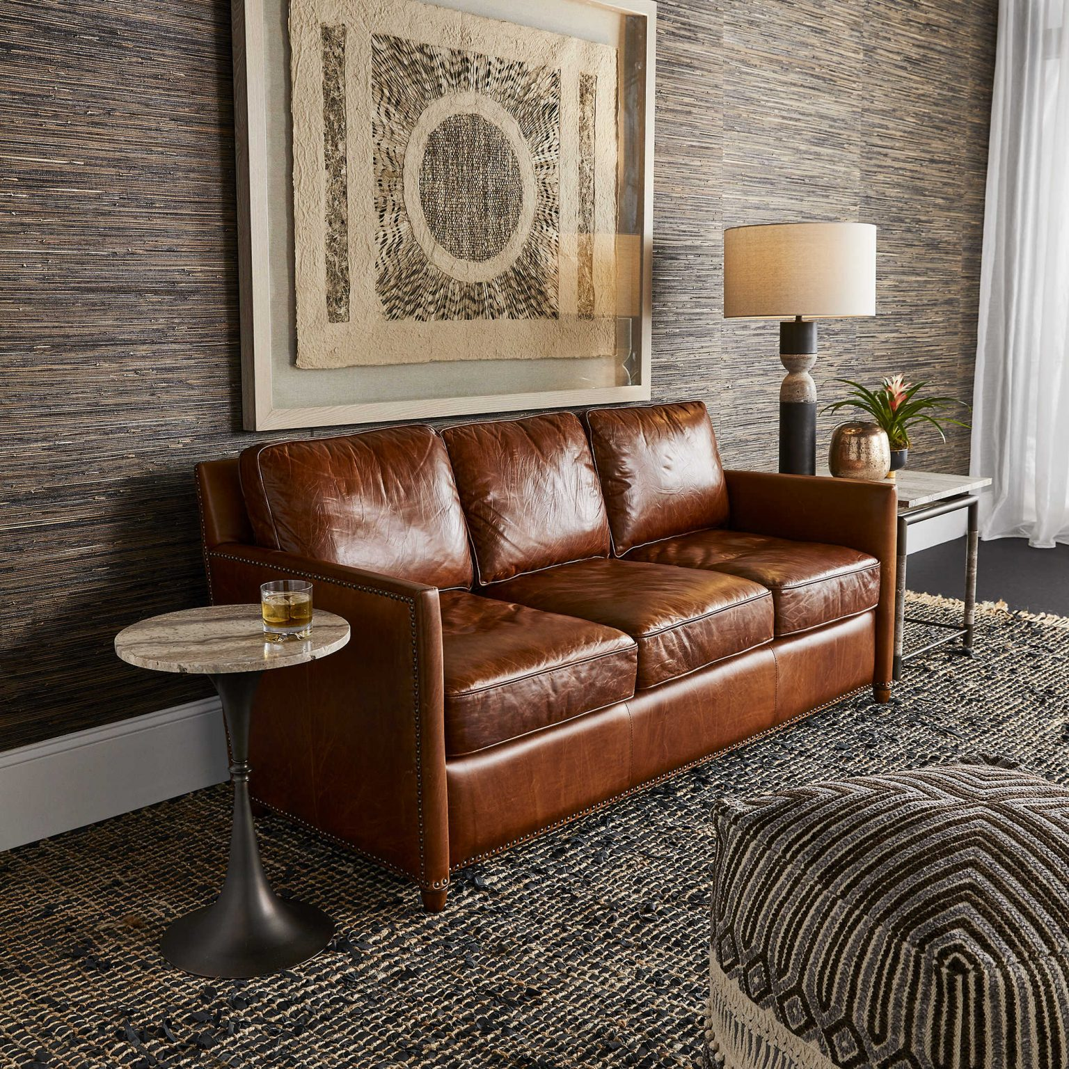 Masculine, leather padded sofa in a chic nostalgic style