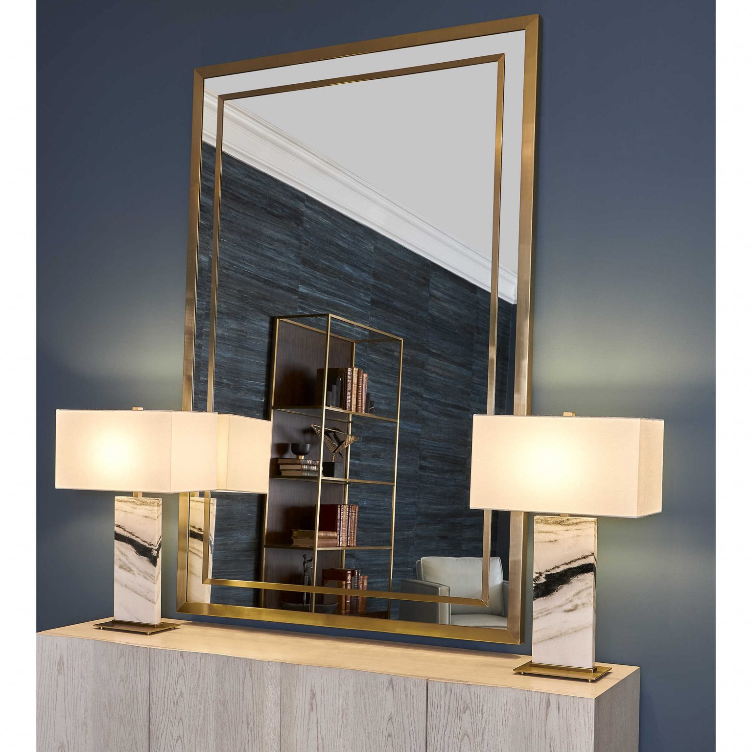 Gold lined mirrors with gold and lamps bring a retro-modern glow