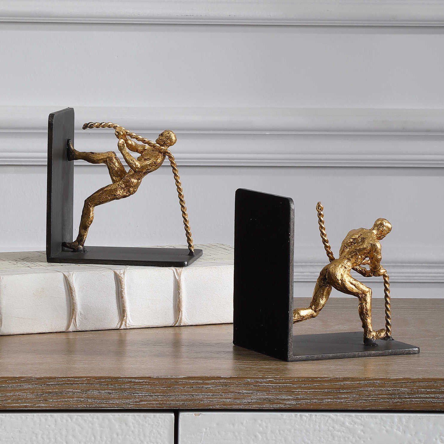 Antique human figurine bookends plated in gold are charming and unique