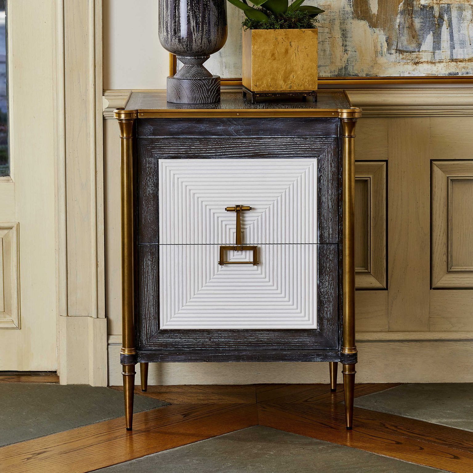 Antique-looking side table with gold and white detailing is granny chic