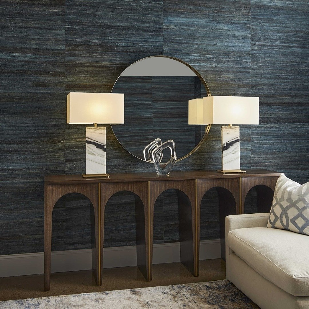 a blue wallpapered room with mid-century modern granny chic decor