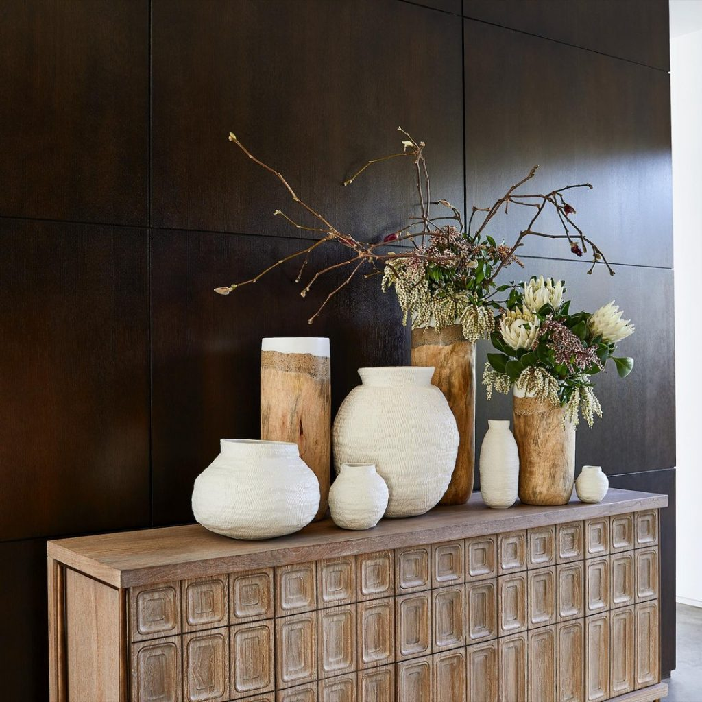 Wood paneled walls with a retro console table