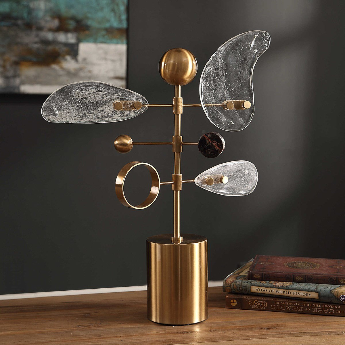 Gold abstract sculpture with geometric shapes