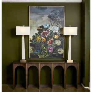 Retro-chic floral print is framed by trendy mid-century lamps and home decor