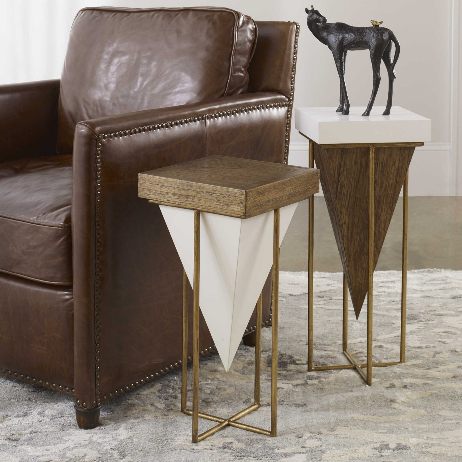 Accent tables featuring geometric shapes and mixed wood give a modern-retro feel to your decor