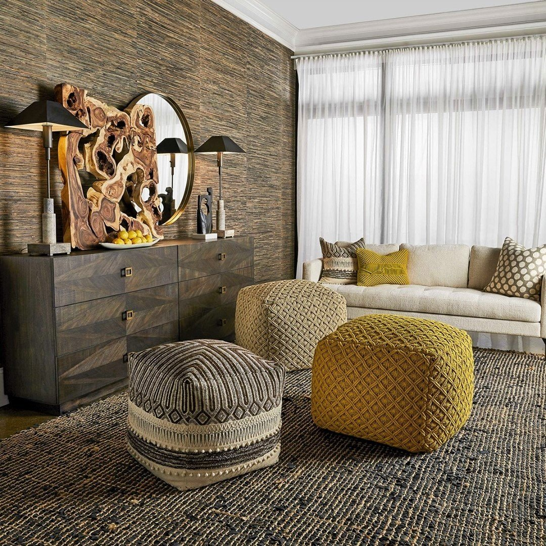 Cozy oversized ottoman's bring warmth to this chic room with their mustard-yellow hue
