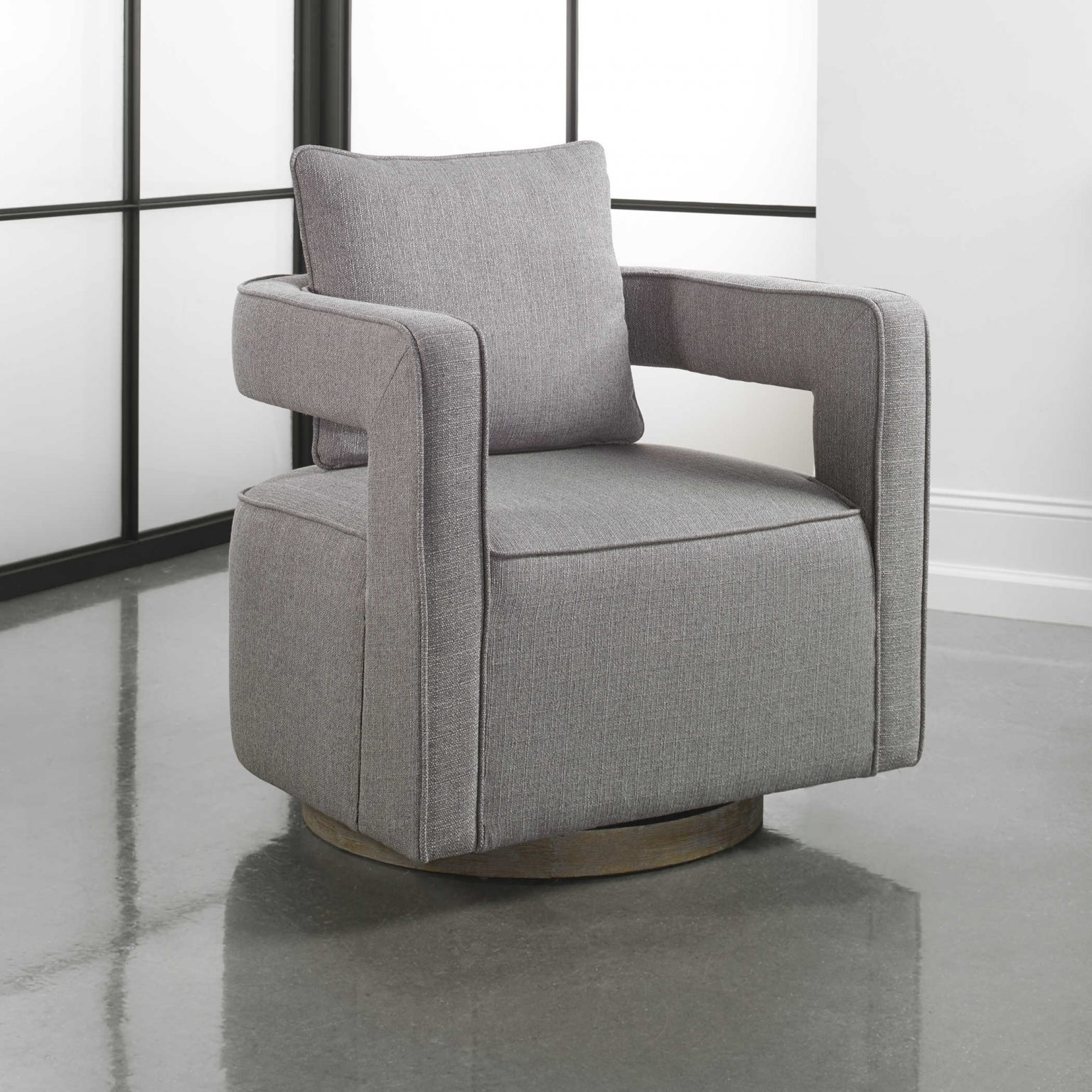 Nostalgic grey swivel chair inspired by the 1970's would look fantastic in a granny chic living room or office