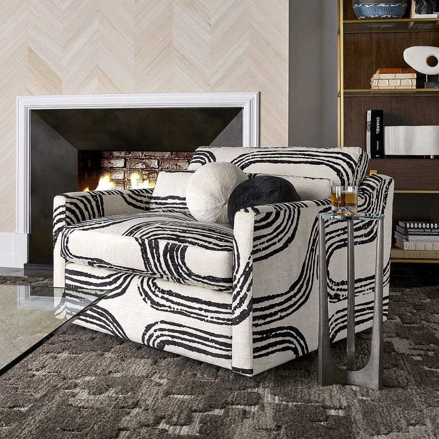 Ovesized 70's chair with bold black and white print