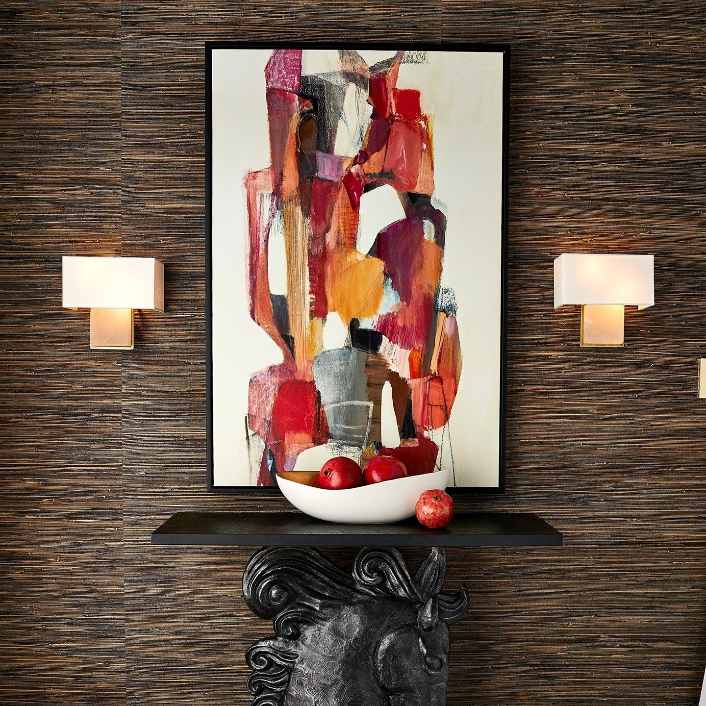 Retro abstract art brings pops or orange and red to this chic room