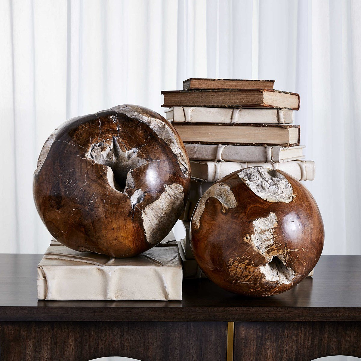 Reclaimed teak wood balls give a retro feel with their geometric shapes