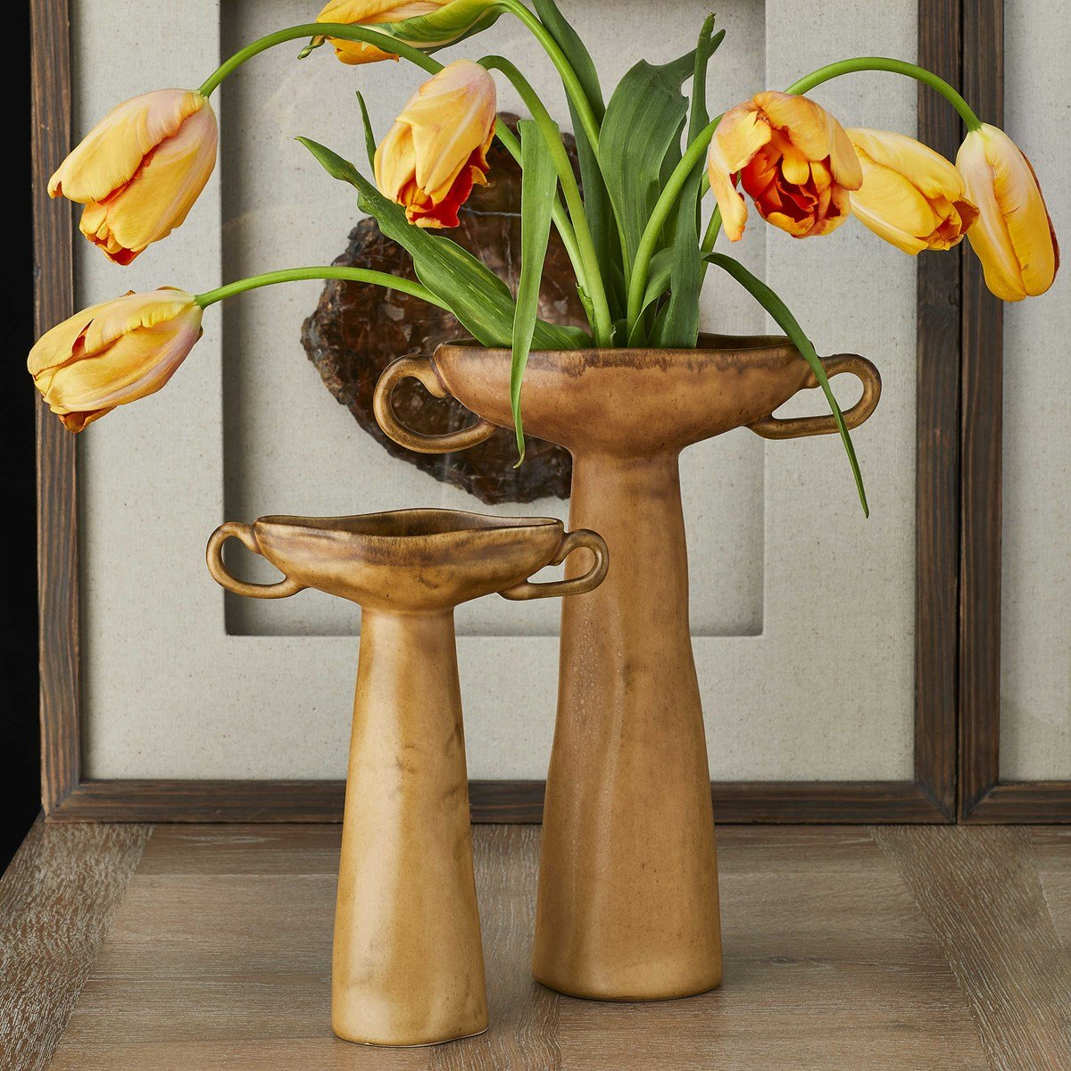 Warped gold vases look chic and retro