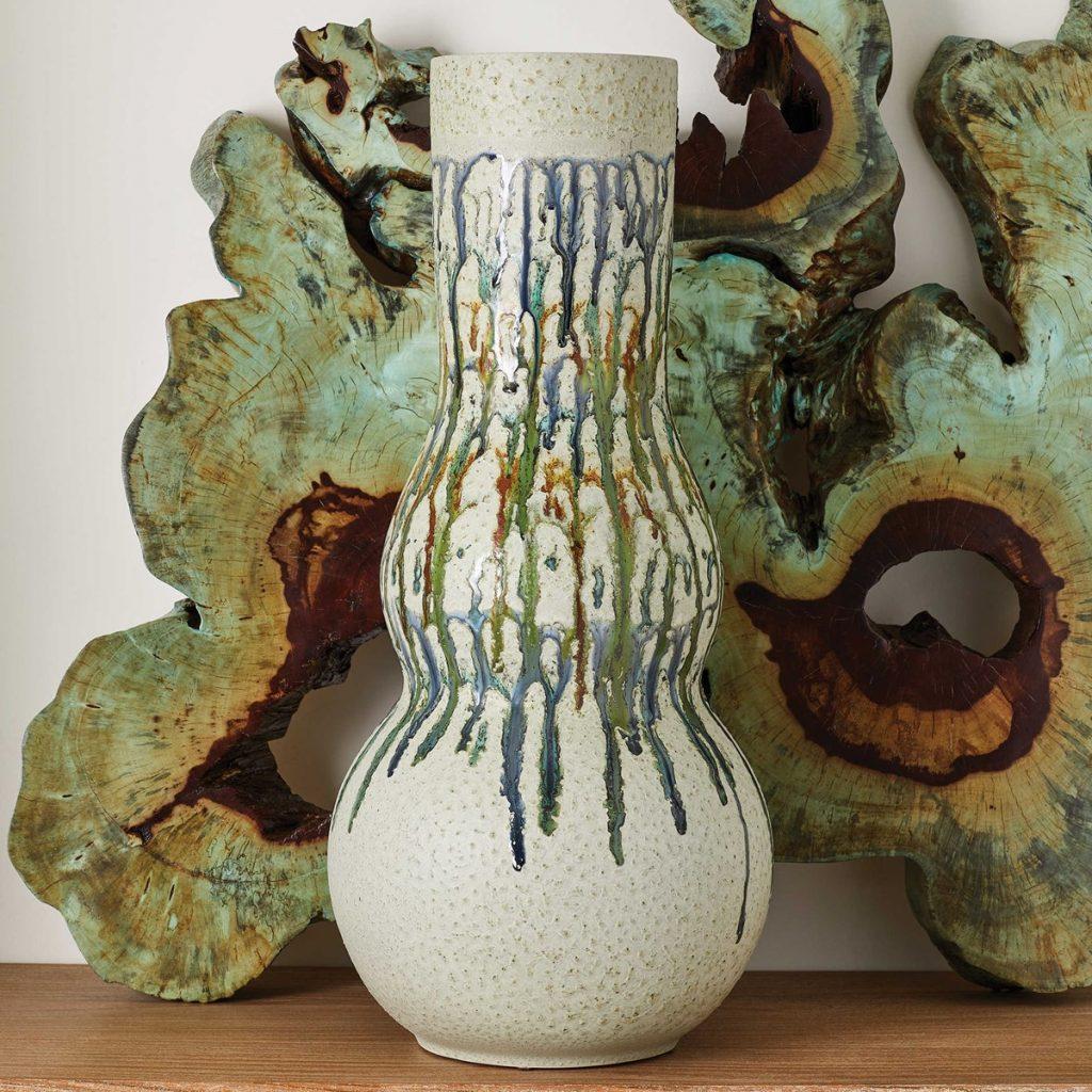 Retro wavy ceramic vase and petrified wood interior decor