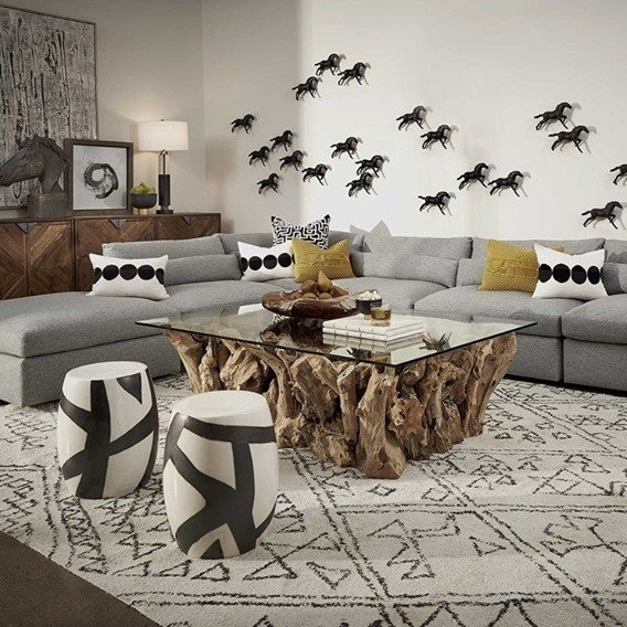 Grey and black living room accented with warm, mustard yellow pillows